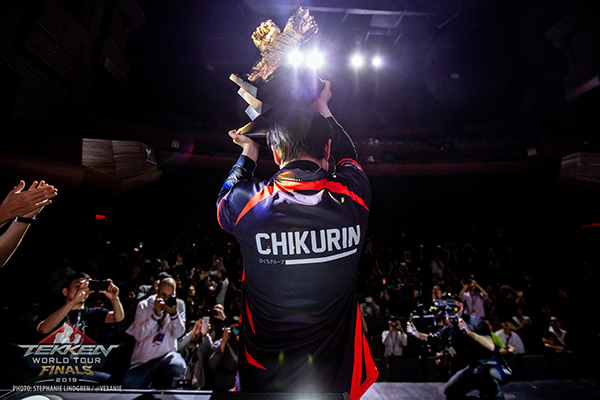 TEKKEN player who holds the winning cup