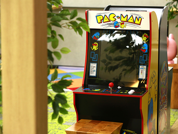 A 2/3 scale PAC-MAN arcade cabinet on display inside the BANDAI NAMCO Entertainment Inc. office